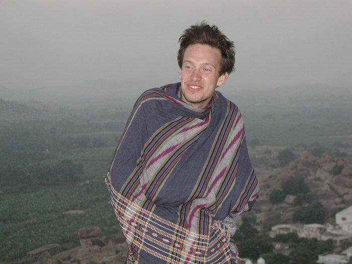 Markus, cold yet happy in the early morning dawn. In Hampi.