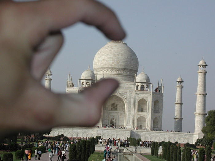 Crushing the head of the Taj Mahal with my mere fingertips (just kidding!!).