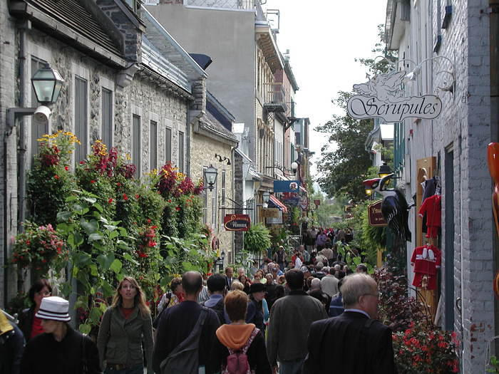 A busy street in Old Quebec. A big cruise shipped was docked in the St. Laurence seaway, nearby.