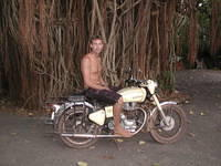 Me on my Enfield Bullet, near a great Banyan Tree in northern Goa, India.