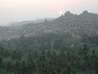 Watching the sun come up in Hampi, from on top of Matanga Hill, the closest hill to climb from the Hampi Bazaar. I carried a sma
